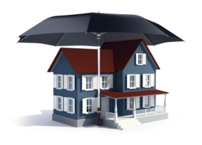 Insurance concept -  house under umbrella
